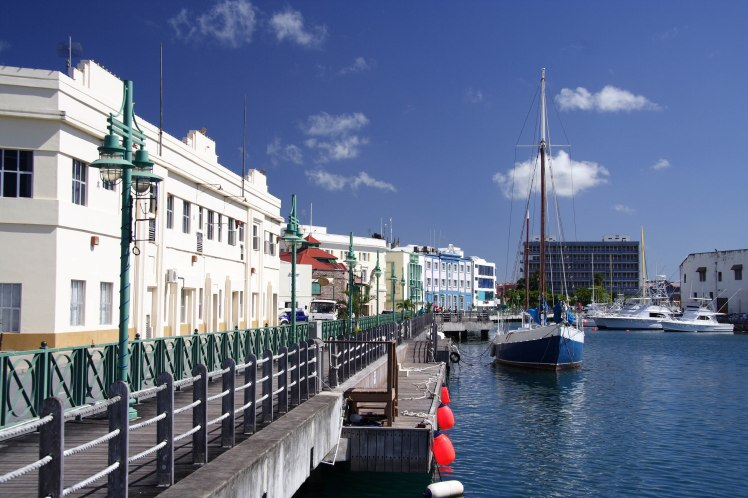 A picture of a seafront surrounded by buildings